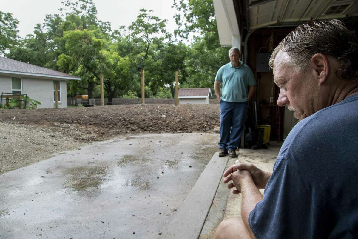 David Bush, right, who had a levee built around his home after it was damaged during Hurricane Harvey, sits in his garage with his contractor, Daniel Dean, Tuesday, June 19, 2018, in Richmond. ( Jon Shapley / Houston Chronicle )