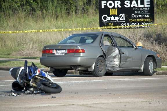 A motorcyclist is dead after slamming into the side of a car in southwest Houston on Friday, June 22, 2018.