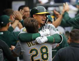 CHICAGO, IL - JUNE 22:  Franklin Barreto #1 of the Oakland Athletics is lifted by teammate Matt Olson #28 after hitting his second three run home run of the game in the 8th inning against the Chicago White Sox at Guaranteed Rate Field on June 22, 2018 in Chicago, Illinois.  (Photo by Jonathan Daniel/Getty Images)