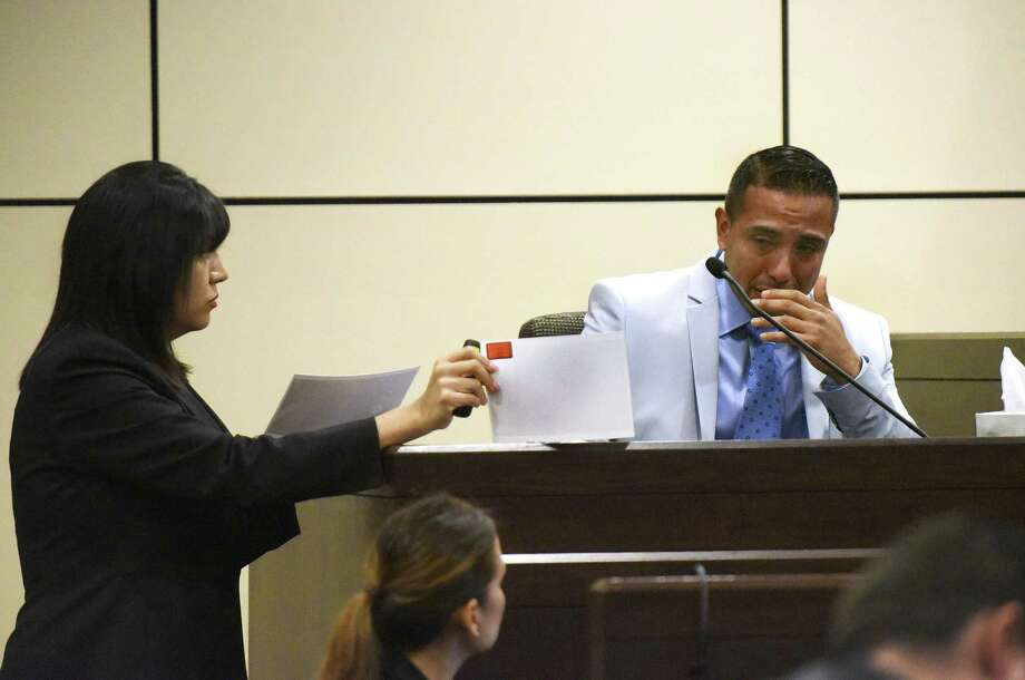 David Asa Villarreal, accused of murder in the fatal stabbing of Aaron Estrada weeps Friday as prosecutor Kimberly Gonzalez shows him a picture of the deceased. Photo: Billy Calzada /San Antonio Express-News / San Antonio Express-News