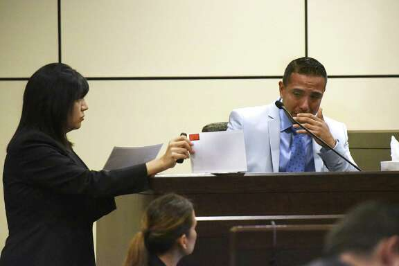David Asa Villarreal, accused of murder in the fatal stabbing of Aaron Estrada weeps Friday as prosecutor Kimberly Gonzalez shows him a picture of the deceased.