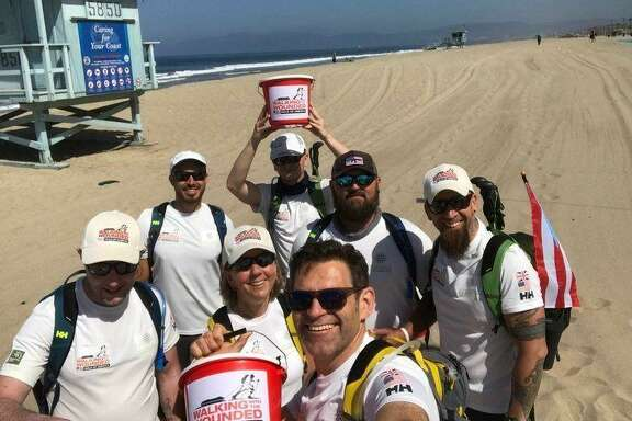 Six military veterans - three British, three American - come through Houston this weekend on a 12-week walk across the United States. They started in California in early June and will end the walk in New York in September.