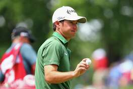 Brian Harman acknowledges the gallery after making a par on the ninth green during the second round of the Travelers Championship on Friday.