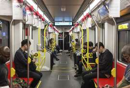 Passengers ride through the Twin Peaks Tunnel on an L train after leaving West Portal Station.