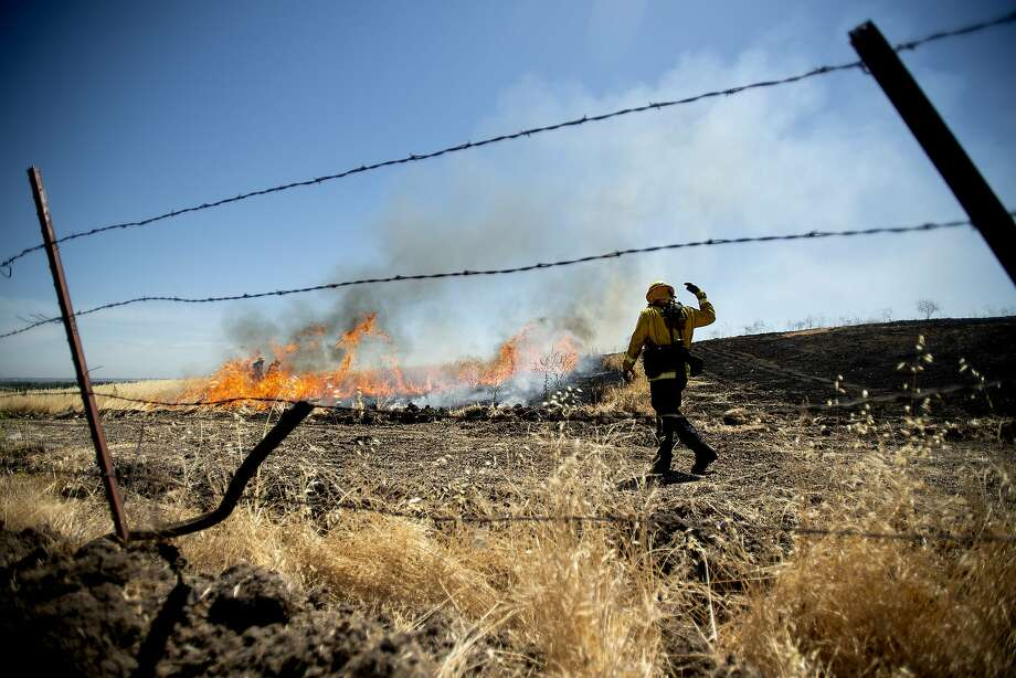 A firefighters practices extinguishing wildfires during training exercises conducted by the Contra Costa Fire Protection District on Tuesday, June 19, 2018, in Antioch, Calif. Photo: Noah Berger / Special To The Chronicle