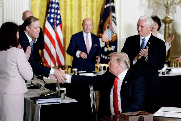 "President Trump shakes the hand of NASA Administrator Jim Bridenstine after signing a directive about space during the National Space Council meeting in the East Room of the White House on June 18, 2018. The president ordered the Pentagon to work on establishing a ""Space Force"" dedicated to the nation's defense in the final frontier."