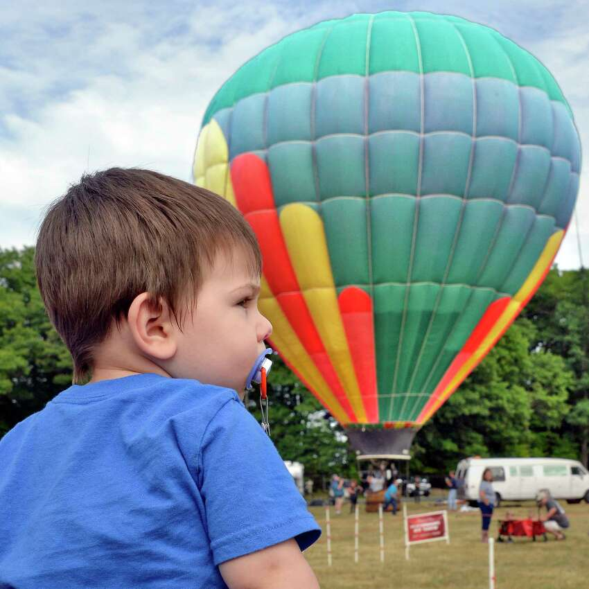 Two-year-old James Nyberg of Queens watches the balloons go up at the 5th Annual Saratoga Balloon and BBQ Festival at the Saratoga County Fairgrounds Friday June 22, 2018 in Ballston Spa, NY. (John Carl D'Annibale/Times Union)