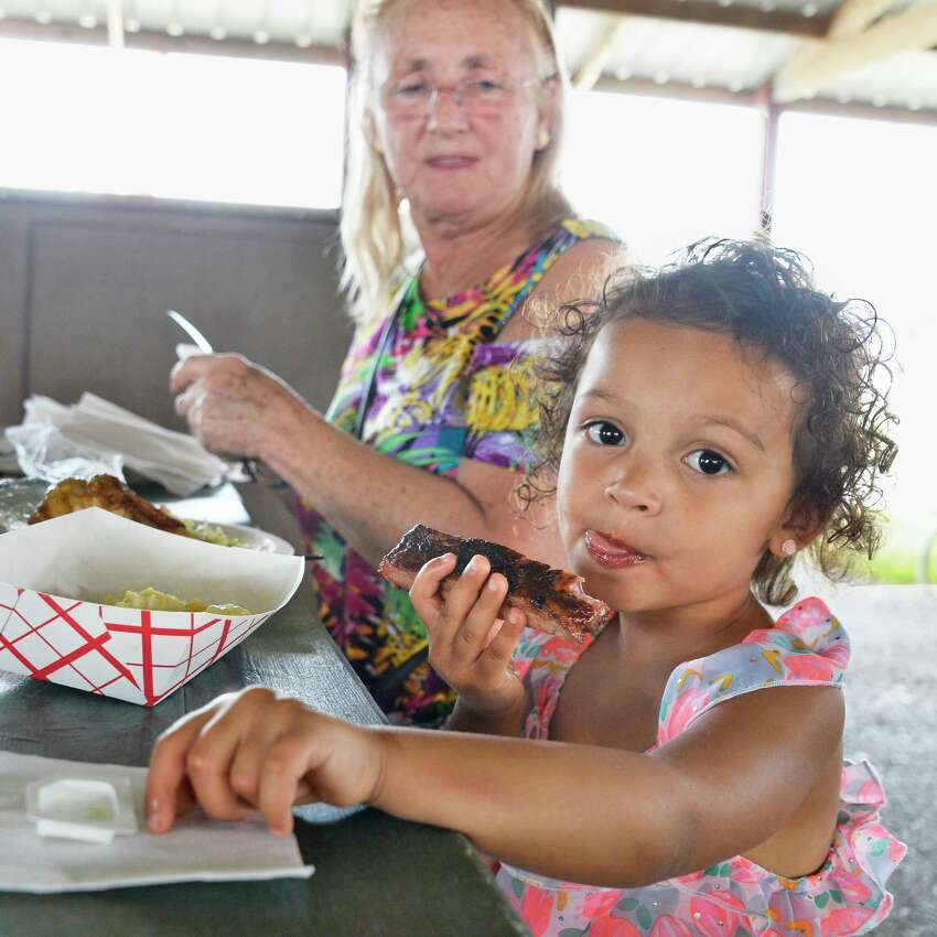 Three-year-old Brielle Thompson eats barbecue with grandma Mary Thomas of Dalton, Mass., during the 5th Annual Saratoga Balloon and BBQ Festival at the Saratoga County Fairgrounds Friday June 22, 2018 in Ballston Spa, NY. (John Carl D'Annibale/Times Union)
