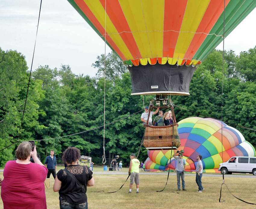 The adventurous take a hot air ballon ride during the 5th Annual Saratoga Balloon and BBQ Festival at the Saratoga County Fairgrounds Friday June 22, 2018 in Ballston Spa, NY. (John Carl D'Annibale/Times Union)