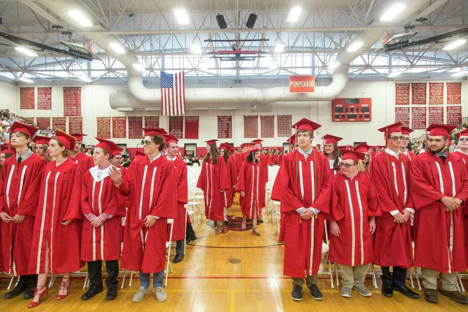 Students make their way into the Pomperaug High School graduation in Southbury, Conn. on Friday, June 22. Photo: Christopher Burns, For Hearst Connecticut Media / The News-Times Freelance