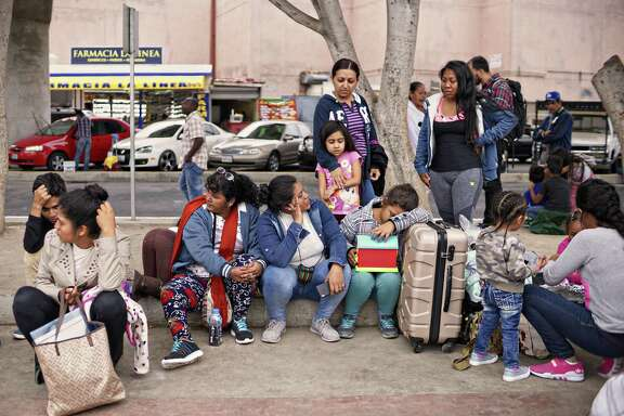 Undocumented migrants wait for asylum hearings outside the U.S. port of entry in Tijuana, Mexico, June 19, 2018.