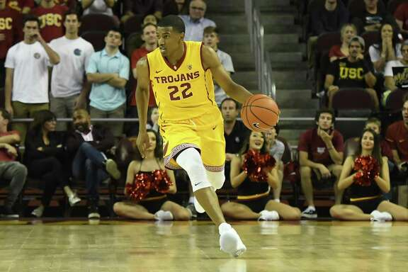 LOS ANGELES, CA - NOVEMBER 25: USC guard DeAnthony Melton (22) brings the ball up the court during an NCAA basketball game between the SMU Mustangs and the USC Trojans on November 25, 2016, at the Galen Center in Los Angeles, CA. (Photo by Brian Rothmuller/Icon Sportswire via Getty Images)