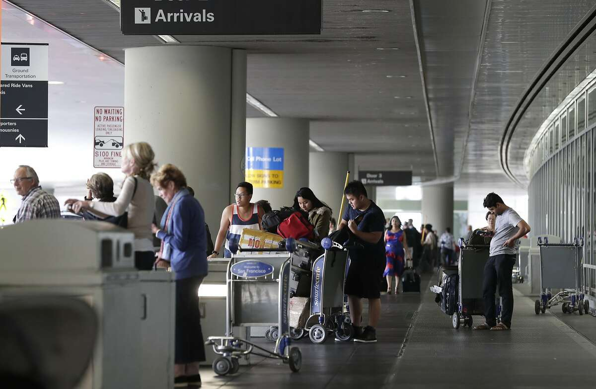 Passengers arrive at San Francisco International airport on Thursday June 29, 2017, as the federal government implements a travel ban on people arriving from six mostly Muslin countries.