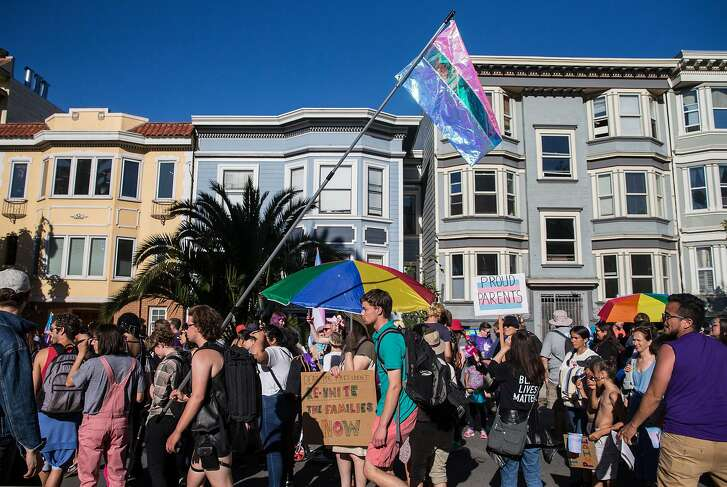 Marchers on Dolores Street during the annual Trans March in San Francisco, Calif. June 22, 2018. The Trump administration is considering defining gender as based on genitalia at birth.