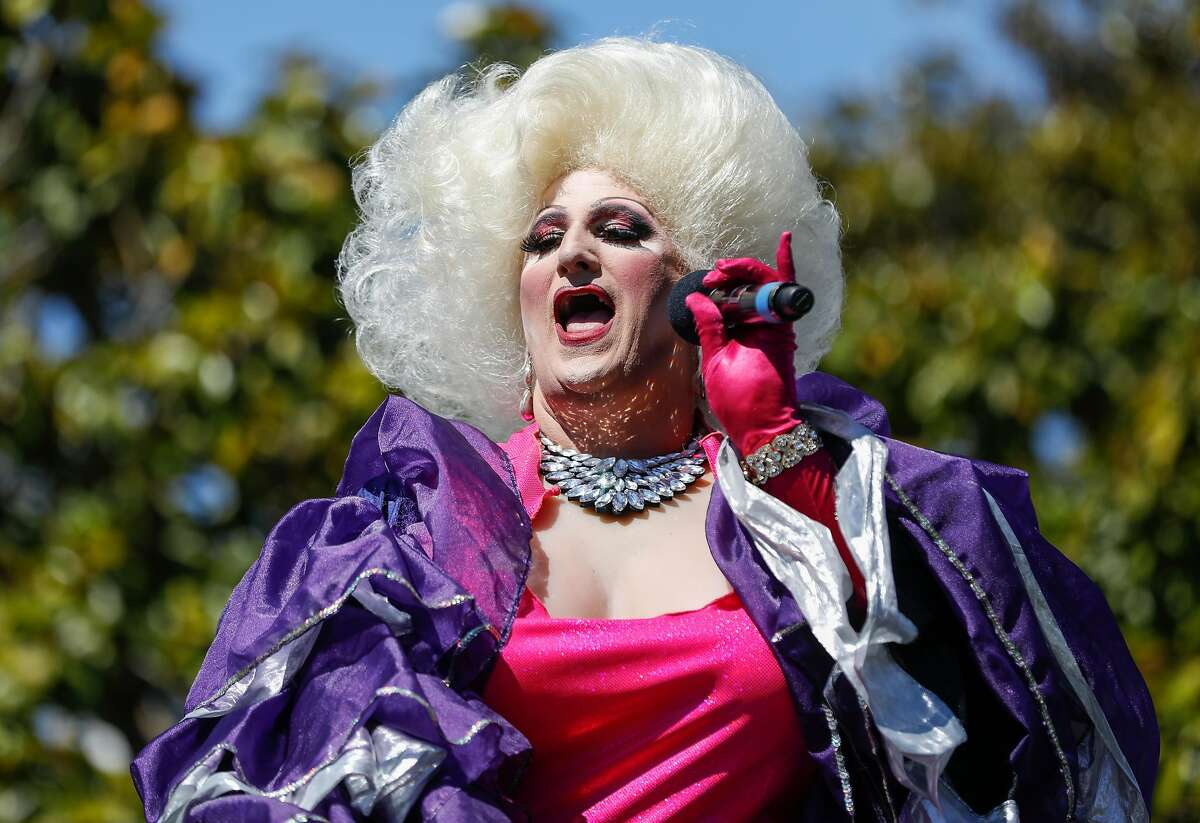 Drag performer Sheena Rose sings to the crowd during the annual Trans March at Mission Dolores Park in San Francisco, Calif. Friday, June 22, 2018.