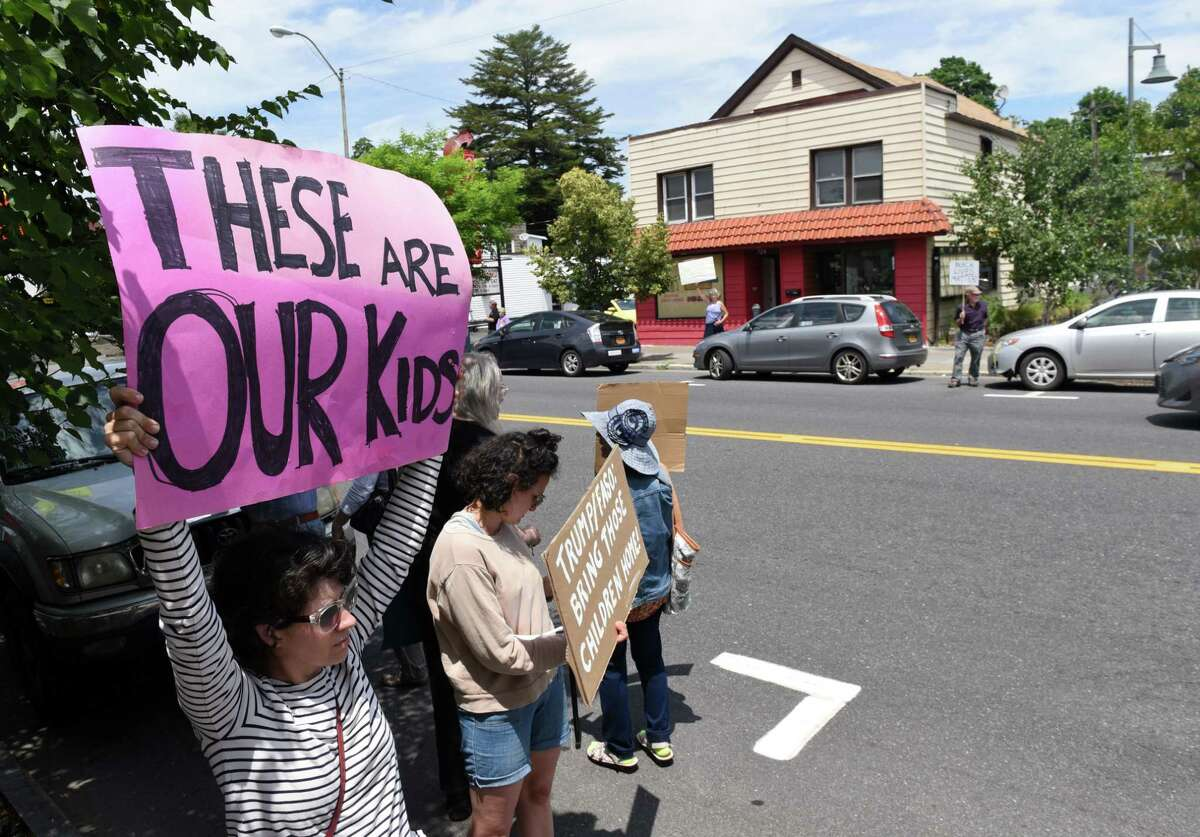 Maggie Mitchell of Woodstock joins demonstrators outside U.S. Rep. John Faso's office to protest the separation of children and parents seeking asylum in the United States on Friday, June 22, 2018, in Kingston, N.Y. (Will Waldron/Times Union)
