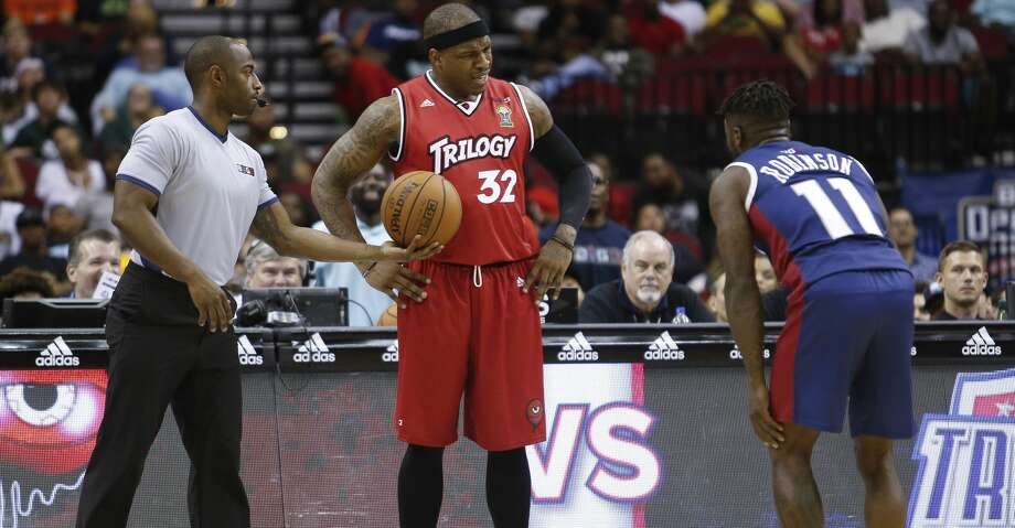 Rashad McCants #32 of Trilogy and Nate Robinson #11 of Tri State argue during the opening night of the Big3 basketball league at the Toyota Center Friday, June 22, 2018. The Big3, a 3-on-3 professional basketball league consisting of retired NBA players, was created by Ice Cube and Jeff Kwatinetz. (Michael Ciaglo / Houston Chronicle) Photo: Michael Ciaglo/Houston Chronicle