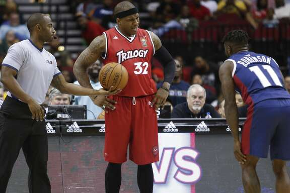 Rashad McCants #32 of Trilogy and Nate Robinson #11 of Tri State argue during the opening night of the Big3 basketball league at the Toyota Center Friday, June 22, 2018. The Big3, a 3-on-3 professional basketball league consisting of retired NBA players, was created by Ice Cube and Jeff Kwatinetz. (Michael Ciaglo / Houston Chronicle)