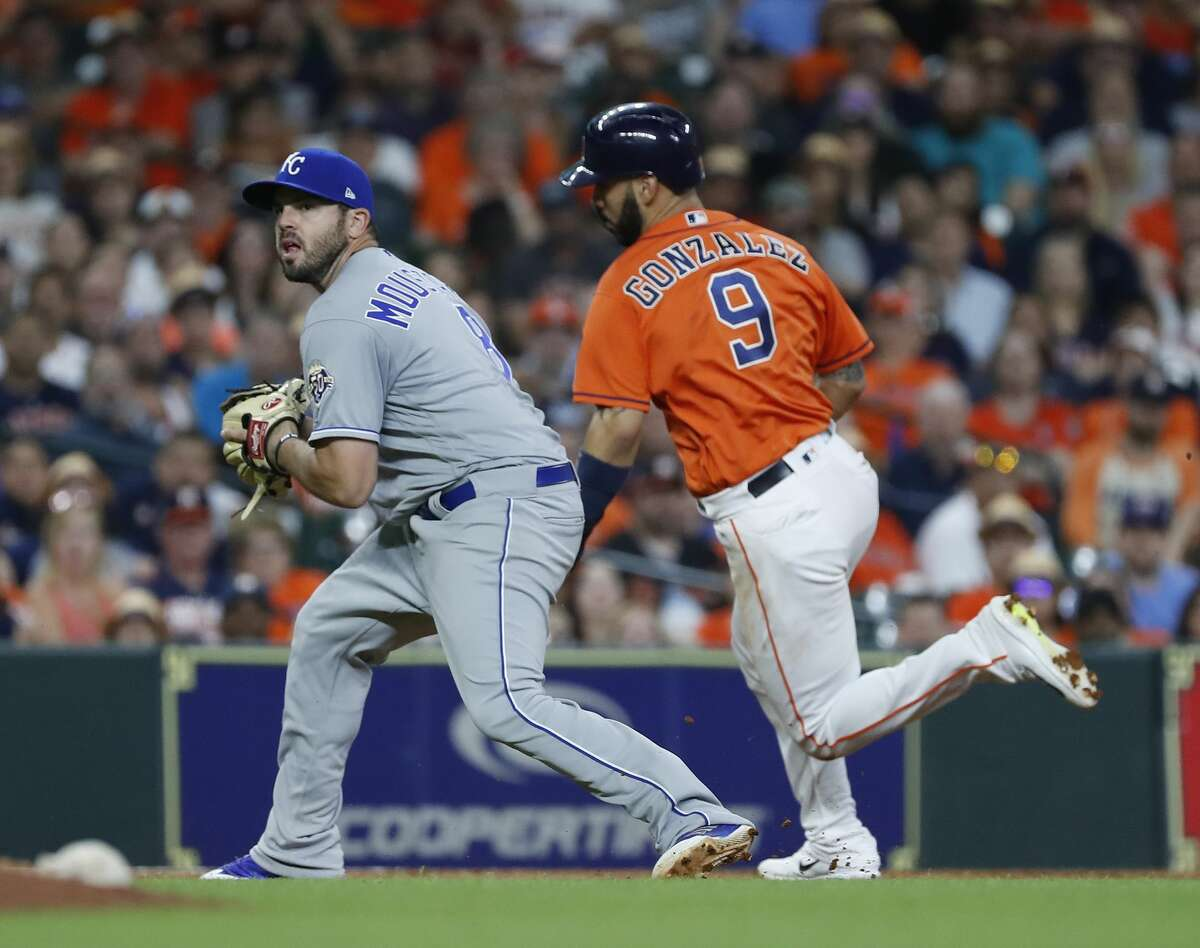 Houston Astros Marwin Gonzalez (9) runs past Kansas City Royals third baseman Mike Moustakas (8) as Tyler White reached on a fielder's choice during the seventh inningof an MLB baseball game at Minute Maid Park, Friday, June 22, 2018, in Houston. ( Karen Warren / Houston Chronicle )