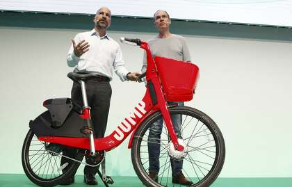 9ab3e38ca77 Uber CEO Dara Khosrowshahi (left) and Axel Springer CEO Christoph Keese  show off Uber's new bike sharing service, Jump. Uber wants to have scooters,  too.