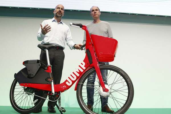 Uber CEO Dara Khosrowshahi (left) and Axel Springer CEO Christoph Keese show off Uber's new bike sharing service, Jump. Uber wants to have scooters, too.