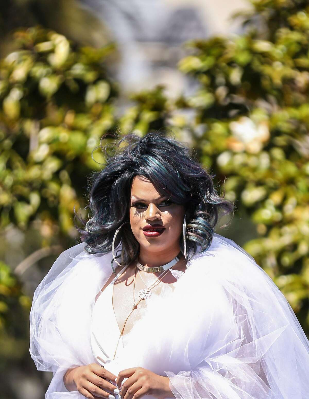 Local Trans activist and drag performer Rexy Amaral sports a flowing white dress while MC'ing the annual Trans March at Mission Dolores Park in San Francisco, Calif. Thursday, June 21, 2018.