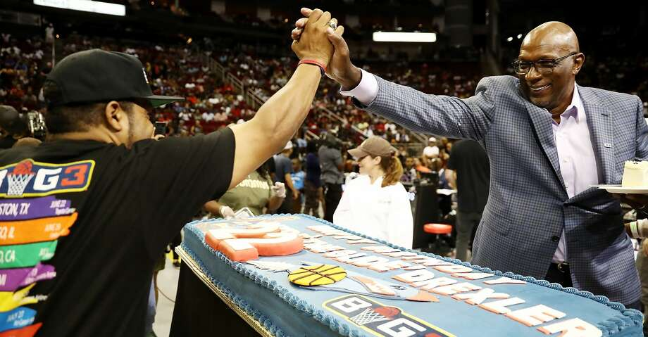 HOUSTON, TX - JUNE 22: BIG3 League Co-Founder, Ice Cube, presents Commissioner, Clyde Drexler, with a birthday cake during week one of the BIG3 three on three basketball league at Toyota Center on June 22, 2018 in Houston, Texas.  (Photo by Ronald Martinez/BIG3/Getty Images) Photo: Ronald Martinez/BIG3/Getty Images