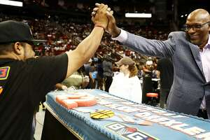 HOUSTON, TX - JUNE 22: BIG3 League Co-Founder, Ice Cube, presents Commissioner, Clyde Drexler, with a birthday cake during week one of the BIG3 three on three basketball league at Toyota Center on June 22, 2018 in Houston, Texas.  (Photo by Ronald Martinez/BIG3/Getty Images)
