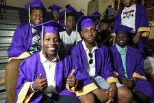 """Noldylens """"Noodles"""" Metayer gives a thumbs up as he sits with his classmates preparing for graduation from Westhill High School on June 22, 2018 in Stamford, Connecticut."""