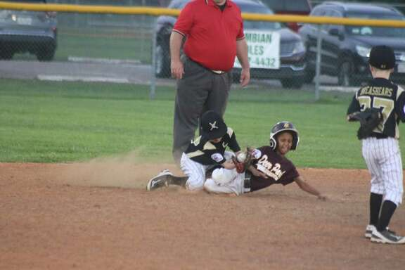 Deer Park Maroon's C.J. Cash slides safely into second base, beating the fielder's choice throw  during third-inning action Friday night. Cash kicked off a third-inning uprising that erased a 1-0 deficit.