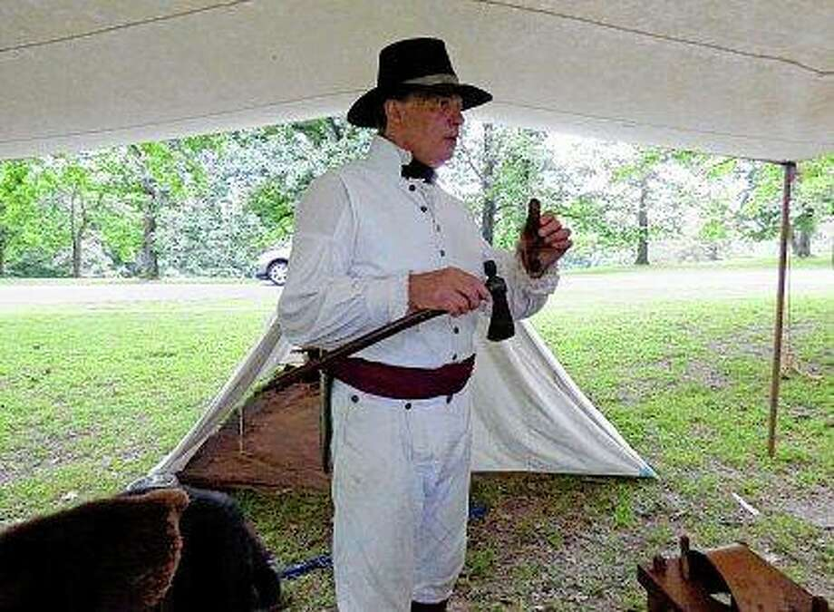 Jan Donelson talks to visitors at Fort Kaskaskia State Historical Site in Ellis Grove while portraying Capt. Meriwether Lewis. Donelson is part of the Lewis and Clark Discovery Expedition, a group of re-enactors from St. Charles, Missouri. Photo:       Marilyn Halstead | The Southern (AP)