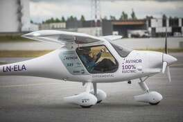 Ketil Solvik-Olsen, Norway's transport minister (left) and Dag Falk-Petersen, chief executive officer of Avinor, sit in the cockpit of an Avinor Alpha Electro G2 electric two-seater plane ahead of its inaugural flight at Oslo airport, in Gardermoen, Norway, on June 18, 2018.