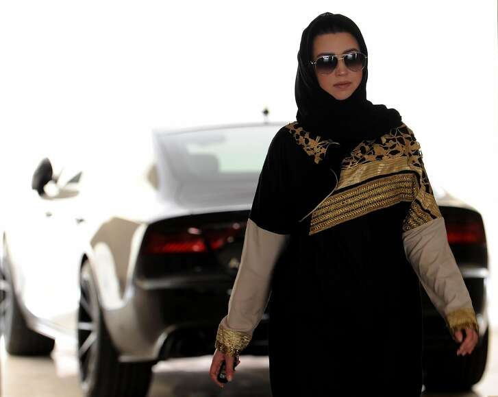 Daniah al-Ghalbi, a newly-licensed Saudi woman driver, walks away from her car in a garage in the Red Sea resort of Jeddah on June 23, 2018, a day before the lifting of a ban on women driving in the conservative Arab kingdom. Saudi Arabia will allow women to drive from June 24, ending the world's only ban on female motorists, a historic reform marred by what rights groups call an expanding crackdown on activists. / AFP PHOTO / Amer HILABIAMER HILABI/AFP/Getty Images