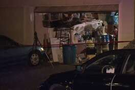"""The """"badly decomposed"""" body of a woman was found in the garage of a west Houston home Friday night, the Houston Police Department said. A red, 2003 Buick LaSabre that belonged to the woman, meanwhile, has been connected to a June 20 """"dine and dash"""" at a Denny's near Chinatown, investigators said. Police officers and Houston Firefighters were called around 10 p.m. to a home in the 12700 block of Leader Street after a neighbor complained about a bad odor. After entering the home, officers found the adult woman, whose name has not been released, laying face down in her garage."""