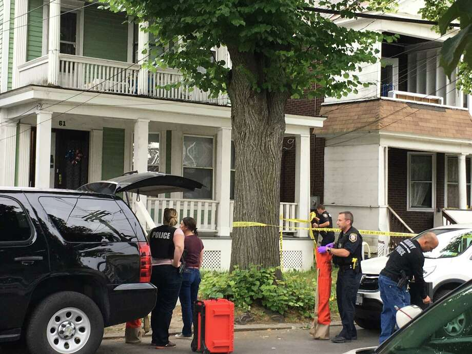 Police and crime tape outside the residence at 61 Partridge St. in Albany on Saturday, June 23, 2018 where police said Schuyler Lake stabbed his mother and uncle. Photo: Madison Iszler/Times Union