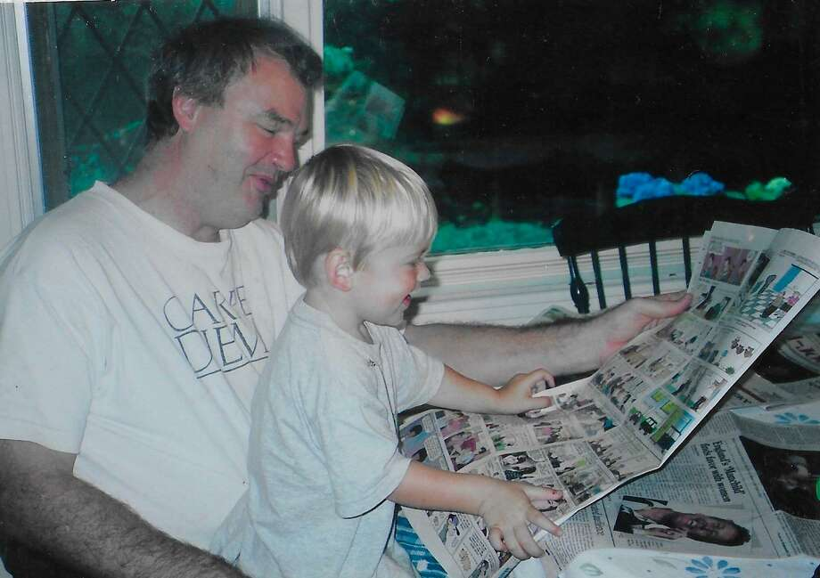 Bip and Ty read the Sunday comics. A love of newspapers runs in the family. Photo: Contributed Photo / James H. Smith