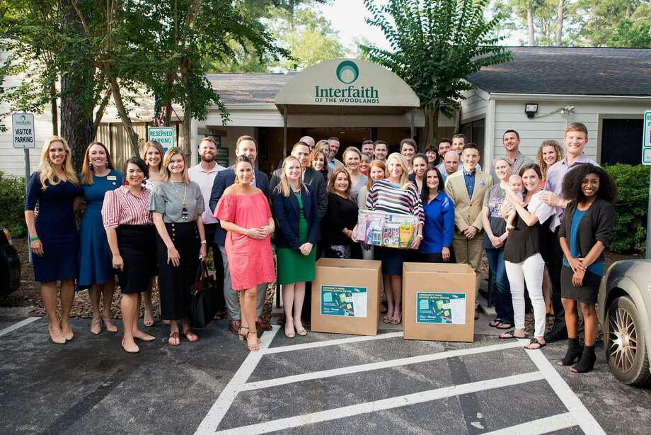 Interfaith is seeking donations to support the more than 2,000 Conroe Independent School Distirct students the organization expects to reach this back-to-school season. Here, Interfaith Young Professionals members prepare to collect school supplies at the 2018 Kits 4 Kidz kick-off. Photo: Courtesy Of Interfaith Of The Woodlands / Courtesy Of Interfaith Of The Woodlands