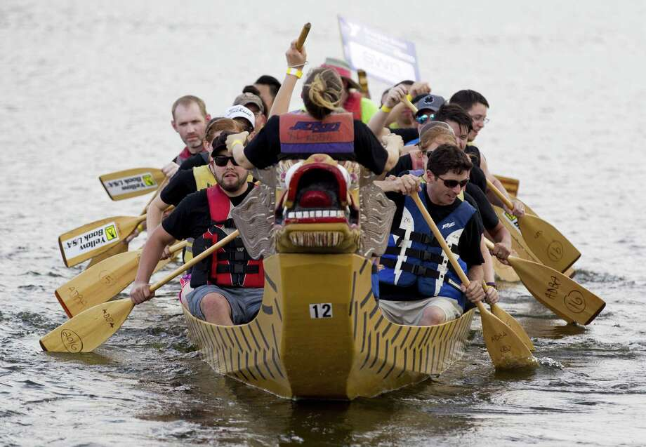 Competitors row as they compete in the boat race portion of the annual YMCA Dragon Boat Team Challenge on Sept. 28, 2017, at Northshore Park in The Woodlands. Photo: Jason Fochtman, Staff Photographer / Houston Chronicle / © 2017 Houston Chronicle
