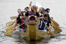 Competitors row as they compete in the boat race portion of the annual YMCA Dragon Boat Team Challenge on Sept. 28, 2017, at Northshore Park in The Woodlands.