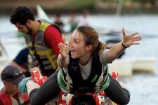 Kendra Williamson reacts as she tries to balance on the end of a dragon boat while grabbing a flag during the annual YMCA Dragon Boat Team Challenge Thursday, Sept. 28, 2017, at Northshore Park in The Woodlands. The popular team building event runs from Sept. 28- Oct. 1 and features six different activities, culminating in teams racing the colorful boats that weight up to 1,800-lbs.