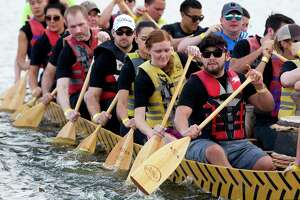 Competitors row as they compete in the boat race portion of the annual YMCA Dragon Boat Team Challenge in this 2017 at Northshore Park in The Woodlands. Officials with the race requested a renewed agreement with The Woolands in 2019, which includes waiving thousands of dollars in park use fees, however the request was put on hold until a future date as township officials ponder changes to the park use fee waiver process.