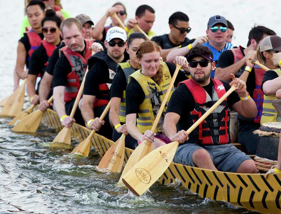 Competitors row as they compete in the boat race portion of the annual YMCA Dragon Boat Team Challenge Thursday, Sept. 28, 2017, at Northshore Park in The Woodlands. Under proposed changes to the park use fee waiver process, the YMCA Dragon Boat Races could lose the $4,800 in waived fees in the future. Officials have said if they do lose the waiver, the event will still continue to occur. Photo: Jason Fochtman, Staff Photographer / Houston Chronicle / © 2017 Houston Chronicle