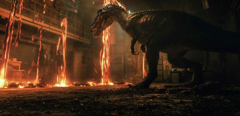 "This image released by Universal Pictures shows Bryce Dallas Howard, left, and Justice Smith in a scene from the upcoming ""Jurassic World: Fallen Kingdom."" (Universal Pictures via AP) / COPYRIGHT © 2018 UNIVERSAL STUDIOS and AMBLIN ENTERTAINMENT, INC"