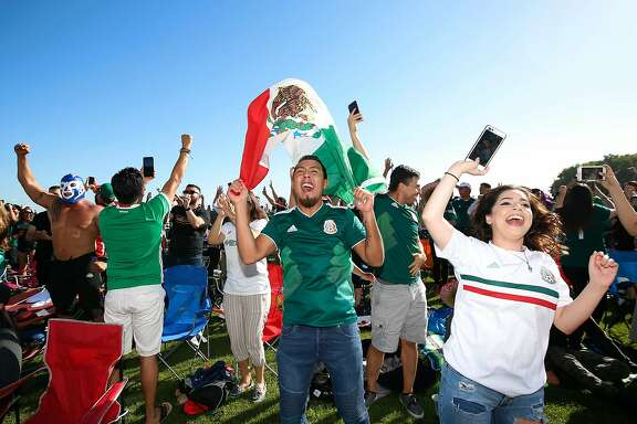 Erik Aguirre, center, with Maria Garcia, right, celebrate as Mexico scores 1-0 penalty kick goal during viewing party at Avaya Stadium, in San Jose, California on June 23, 2018. 5000  fans attended viewing party for the 2018 FIFA World Cup Russia match Mexico vs Korea Republic. (Josie Lepe / Special to the Chronicle)