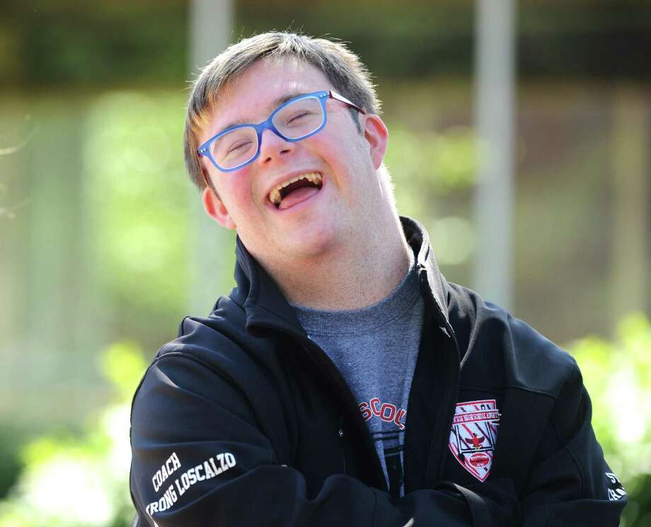 GHS student student rugby coach Matthew Armstrong Loscalzo, 17, chats in the courtyard at Greenwich High School in Greenwich, Conn. Thursday, June 21, 2018. Coach Armstrong Loscalzo, who has Down syndrome, is known for giving speeches before and after games to boost team morale and remind everybody to have fun. Photo: Tyler Sizemore / Hearst Connecticut Media / Greenwich Time