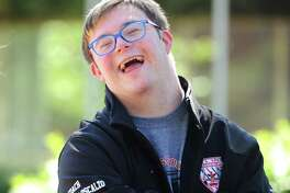 GHS student student rugby coach Matthew Armstrong Loscalzo, 17, chats in the courtyard at Greenwich High School in Greenwich, Conn. Thursday, June 21, 2018. Coach Armstrong Loscalzo, who has Down syndrome, is known for giving speeches before and after games to boost team morale and remind everybody to have fun.