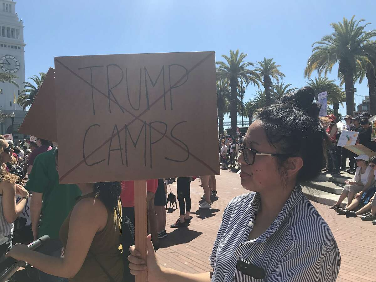 Erica Hernandez holds a sign during an immigration rally Saturday at Embarcadero Plaza in San Francisco.