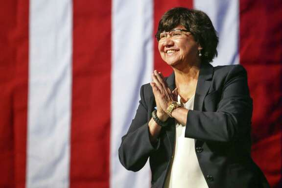Gubernatorial candidate Lupe Valdez is greeted by the crowd as she takes the stage during the general session at the Texas Democratic Convention Friday, June 22, 2018, in Fort Worth, Texas. (AP Photo/Richard W. Rodriguez)