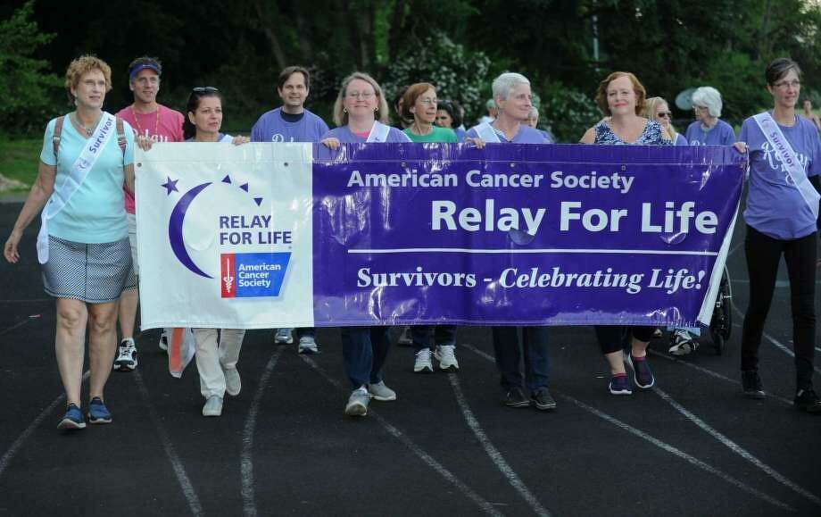 Participants walk in Relay For Life, the signature fundraiser for the American Cancer Society, at Wilton High School on June 8. The American Cancer Society recently lowered the recommended screening age for those at average risk for colon cancer from 50 to 45. Photo: / Erik Trautmann / Hearst Connecticut Media