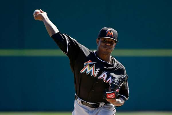 Miami Marlins starting pitcher Edwin Jackson throws in the third inning against the Washington Nationals in a spring training baseball game, Monday, March 7, 2016, in Viera, Fla. (AP Photo/John Raoux)